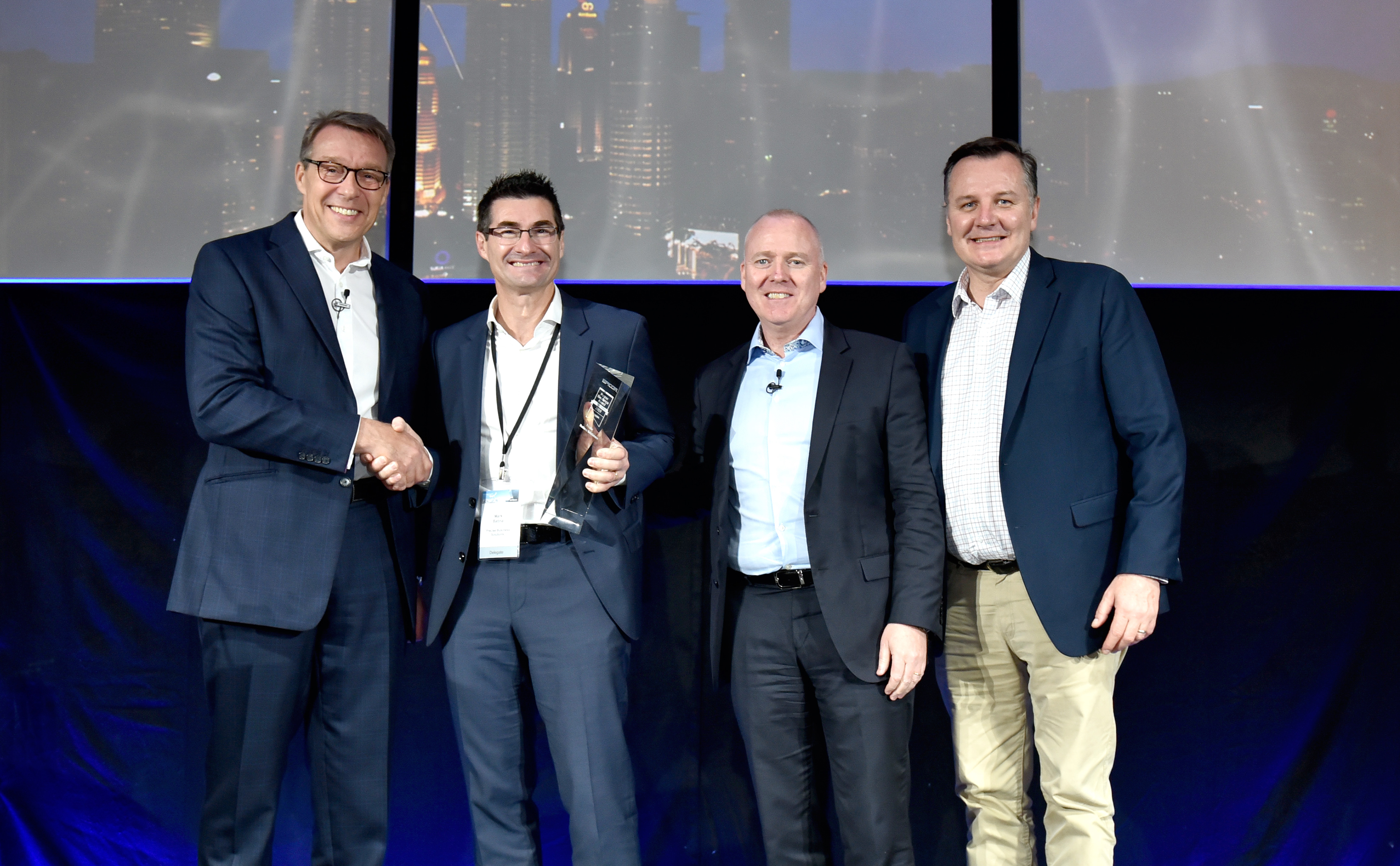 Managing Director Mark Batina accepting the 2019 Customer Excellence Award at the Epicor ANZ Insights conference