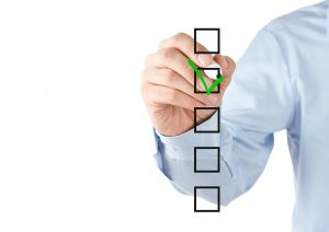 Businessman tiks boxes on his checklist for selecting an ERP provider